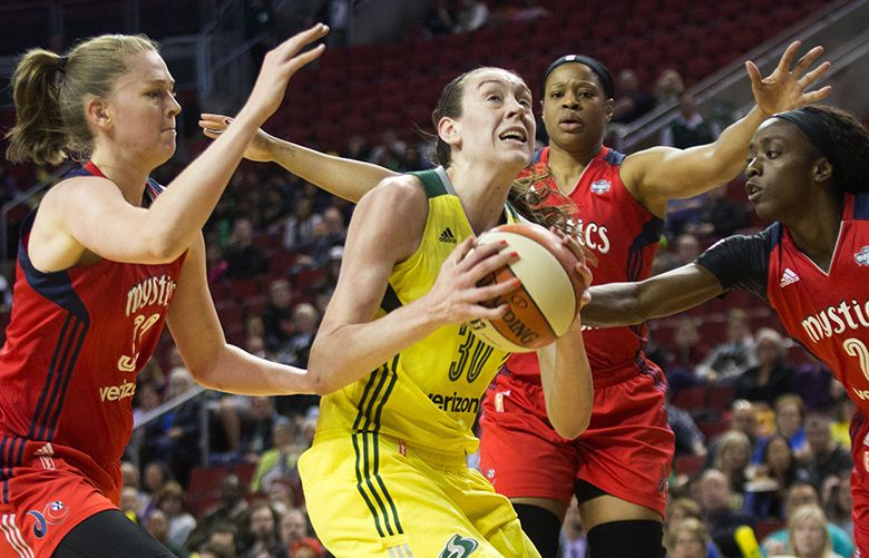 Storm forward Breanna Stewart gets swarmed by Washington Mystics center Emma Meesseman, center Kia Vaughn and guard/forward Kahleah Cooper, getting fouled by Meesseman, in the first half during a game between the Seattle Storm and Washington Mystics at KeyArena on Thursday, May 26, 2016.