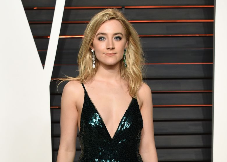 """FILE – In this Feb. 28, 2016 file photo, Saoirse Ronan arrives at the Vanity Fair Oscar Party in Beverly Hills, Calif. The Irish Repertory Theatre will host a gala benefit performance of """"Finian's Rainbow,""""  at The Town Hall in New York on June 13. (Photo by Evan Agostini/Invision/AP, File)"""