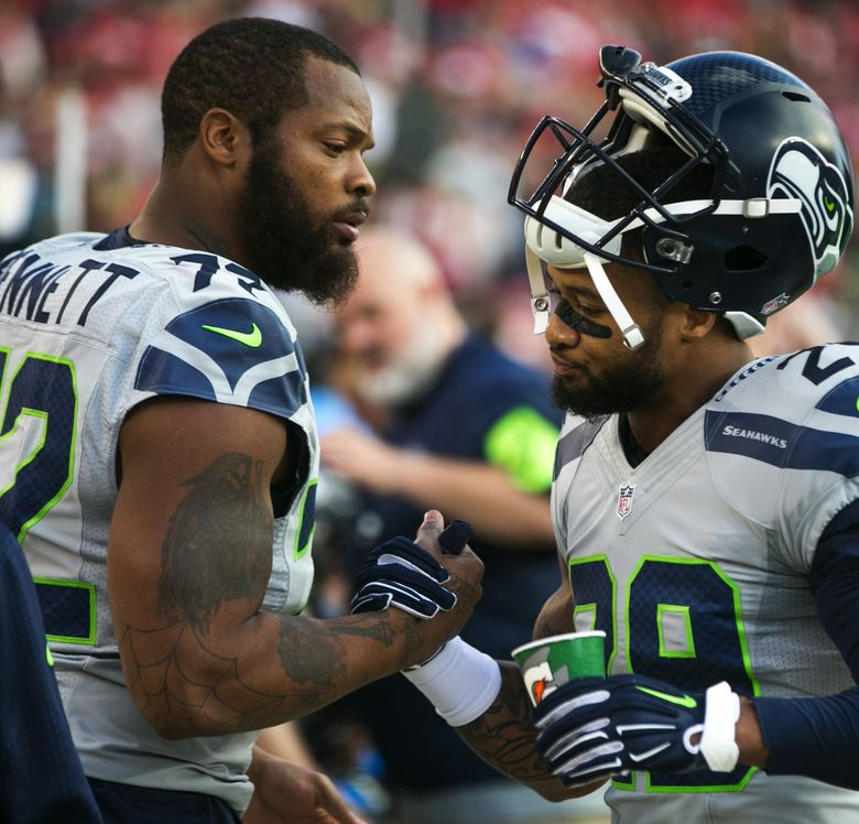 SEAHAWKS FILE —   Seahawks defensive lineman Michael Bennett shakes hands with safety Earl Thomas before the Seattle Seahawks defeat the San Francisco 49ers 20-3 for Thursday Night Football at Levi's Stadium in Santa Clara, California October 22, 2015. (Bettina Hansen / The Seattle Times)