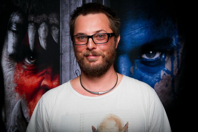 """FILE – In this Nov. 6, 2015 file photo, filmmaker Duncan Jones poses for a portrait during Blizzcon at the Anaheim Convention Center in Anaheim, Calif. Jones directed """"Warcraft,"""" an adaptation of the long-running role-playing game, which centers on the conflict between orcs and humans depicted in """"World of Warcraft"""" and the original """"Warcraft"""" games from the 1990s. The film, starring Travis Fimmel, Dominic Cooper, Ben Foster, Toby Kebbell and Paula Patton, opens June 10. (Photo by Rich Fury/Invision/AP, File)"""