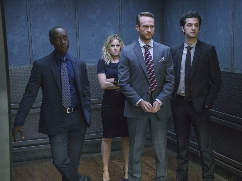 """In this image released by Showtime, Don Cheadle as Marty Kaan, from left, Kristen Bell as Jeannie Van Der Hooven, Ben Schwartz as Clyde Oberholt and Josh Lawson as Doug Guggenheim appear in a scene from, """"House of Lies."""" The Showtime comedy is wrapping its five-season run with a finale filmed entirely on location in Havana. The episode, titled """"No Es Facil,"""" premieres June 13. (Michael Desmond/Showtime via AP)"""