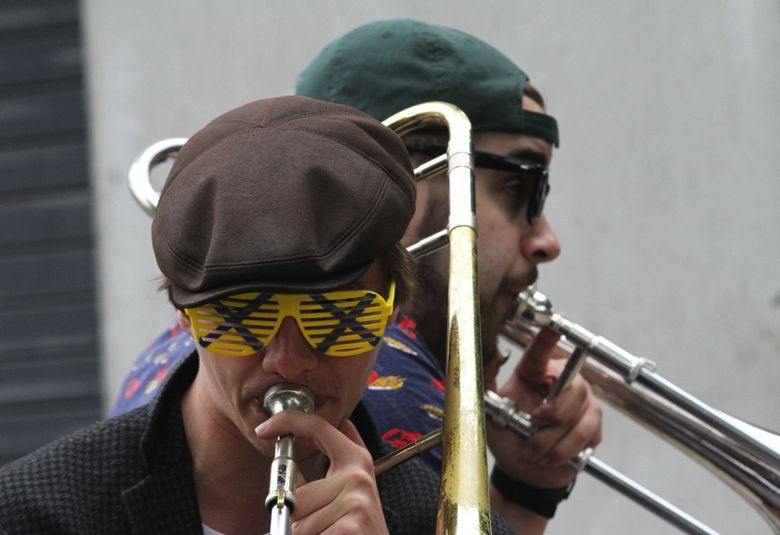 Seattle's Ten Man Brass Band does a funk-jam mashup at the Northwest Folklife Festival in 2015. This year's fest runs May 27-30 at Seattle Center.  (Alan Berner / The Seattle Times)