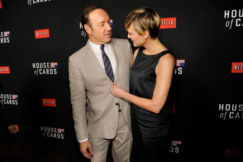 """FILE – In this Feb. 13, 2014, file photo, Kevin Spacey, left, and Robin Wright arrive at a special screening for season 2 of """"House of Cards"""" in Los Angeles. The Huffington Post reported that Wright said during an interview at the Rockefeller Foundation on Tuesday, May 17, 2016, that she demanded the same pay as co–star Kevin Spacey for her work on Netflix's """"House of Cards."""" (Photo by Chris Pizzello/Invision/AP, File)"""