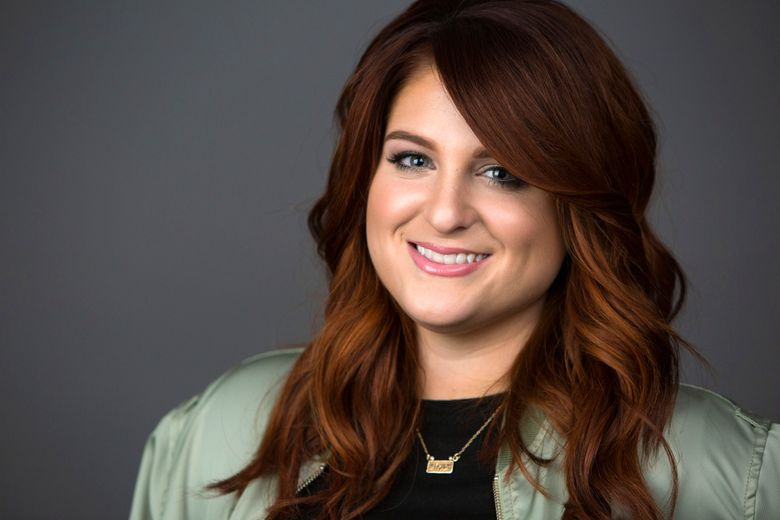 """FILE – In this March 9, 2016, file photo, singer Meghan Trainor poses for a portrait in New York. Trainor removed the video for """"Me Too"""" from YouTube and Vevo on Monday, May 9, 2016, after she discovered she had been digitally altered. (Photo by Amy Sussman/Invision/AP, File)"""