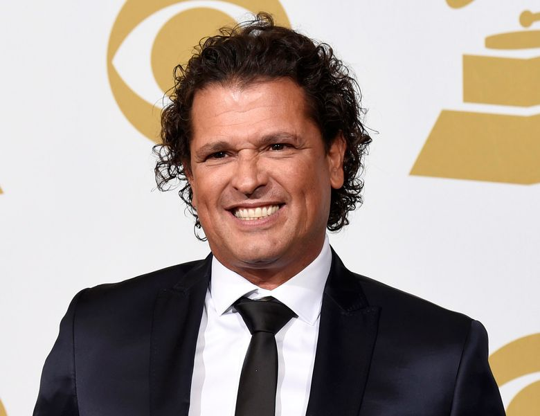 """FILE – In this Feb. 8, 2015 file photo, Carlos Vives poses in the press room at the 57th annual Grammy Awards in Los Angeles. Vives' song, """"La bicicleta,"""" a collaboration with Shakira, will be released on Friday, May 27. (Photo by Chris Pizzello/Invision/AP, File)"""