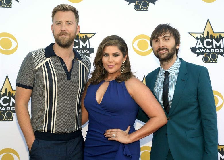 FILE – In this April 19, 2015 file photo, Charles Kelley, from left, Hillary Scott and Dave Haywood, of Lady Antebellum, arrive at the 50th annual Academy of Country Music Awards in Arlington, Texas. The group will host the 10th annual ACM Honors show, which will be televised for the first time on Aug. 30, 2016, in Nashville, Tenn. It will honor Glen Campbell, Tanya Tucker, Carrie Underwood, Keith Urban and Little Big Town. (Photo by Jack Plunkett/Invision/AP, File)