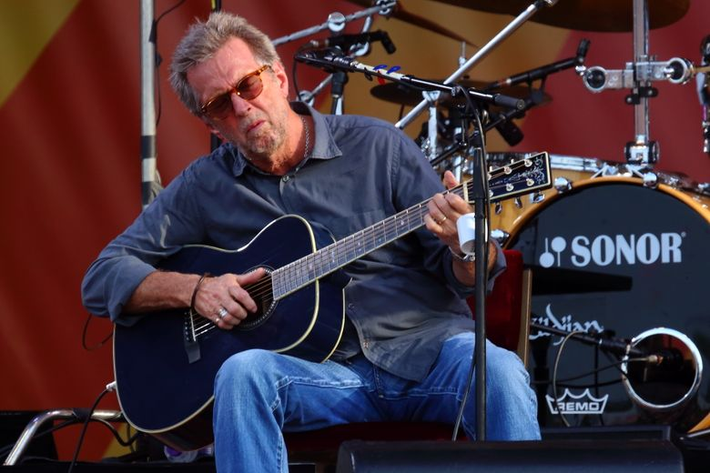 """FILE – In this April 27, 2014 file photo, Eric Clapton performs at the 2014 New Orleans Jazz & Heritage Festival at Fair Grounds Race Course  in New Orleans. Clapton's new album, """"I Still Do,"""" will be released on Friday. (Photo by John Davisson/Invision/AP)"""