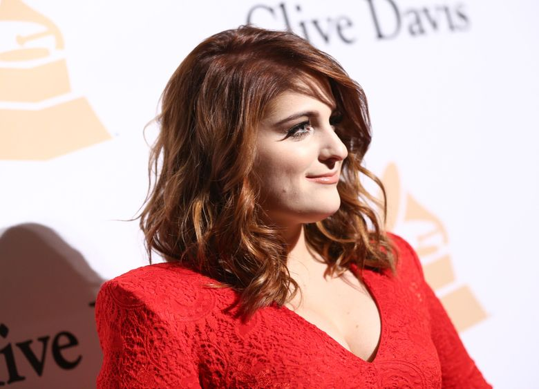"""FILE – In this Feb. 14, 2016, file photo, Meghan Trainor arrives at the 2016 Clive Davis Pre-Grammy Gala at the Beverly Hilton Hotel in Beverly Hills, Calif. Trainor fell at the end of a performance on NBC's """"Tonight Show Starring Jimmy Fallon"""" on May 12, 2016. (Photo by John Salangsang/Invision/AP, File)"""
