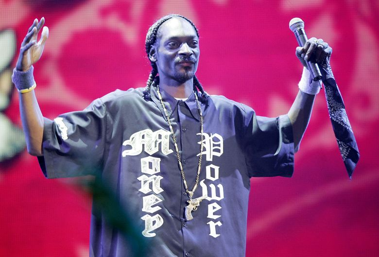 """FILE – In this Sept. 22, 2005 file photo, rap artist Snoop Dogg performs at the """"VH1 Hip Hop Honors"""" show in New York. VH1's Hip Hop Honors is returning to celebrate the pioneers of the genre. The network announced Monday, May 23, 2016, that the show would air live from New York City on July 11. While no honorees were announced, VH1 said it would focus exclusively on female """"trailblazers and trend-setters"""" in the male-dominated field. (AP Photo/Jeff Christensen, File)"""