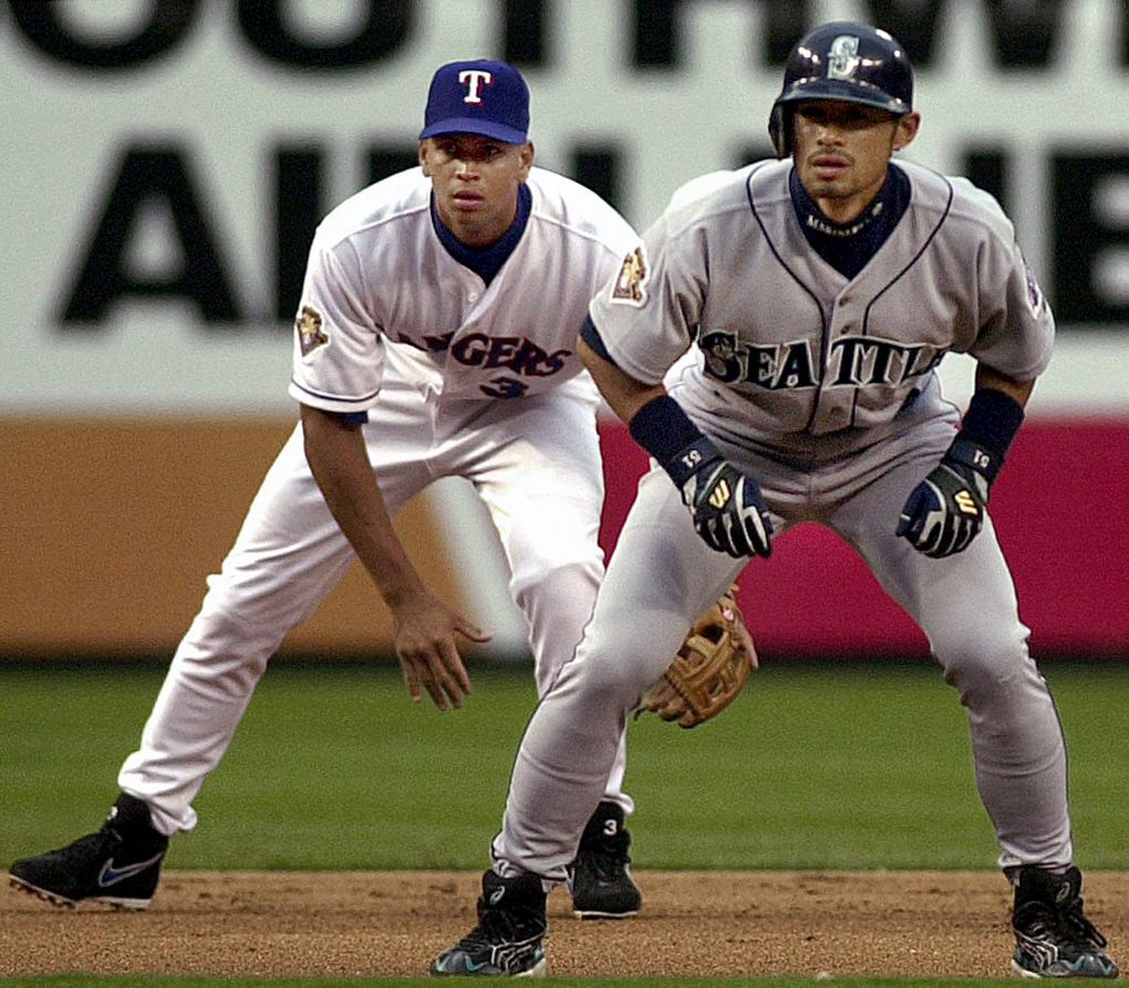 Seattle Mariners' Ichiro Suzuki, front, and Texas Rangers shortstop Alex Rodriguez (3) stand ready during the first inning in Arlington, Texas, Friday, April 6, 2001. Suzuki reached base on a lead-off double and scored on a two-run homer by Mark McLemore.  (AP Photo/LM Otero)