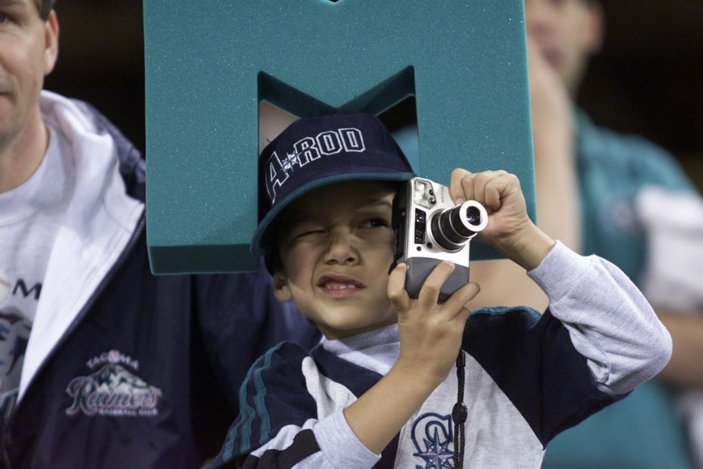 Ryan Ogburn, 6 years of Gig Harbor, takes pictures of the New York Yankees batting practice before Game 3 of the ALCS.  PRE GAME IMAGES Seattle Mariners and New York Yankees  at Safeco Field for ALCS Game 3
