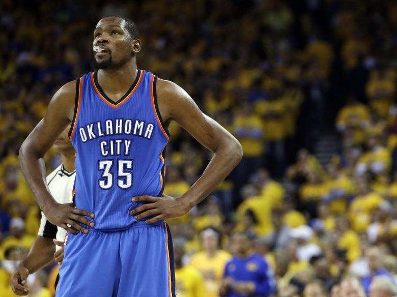 Oklahoma City Thunder star Kevin Durant watches during the closing minutes of the second half in Game 5 of the NBA's Western Conference finals against the Golden State Warriors in Oakland, Calif.  (AP Photo/Marcio Jose Sanchez)