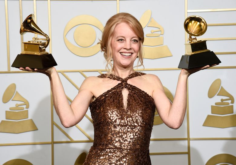 """FILE – In this Feb. 15, 2016 file photo, Maria Schneider poses with the award for best arrangement, instruments and vocals for """"Sue (Or In A Season Of Crime) """" and the award for best large jazz ensemble album for """"The Thompson Fields"""" in the press room at the 58th annual Grammy Awards in Los Angeles. Schneider took home a few 2016 Jazz Awards, one for musician of the year and best album for """"The Thompson Fields."""" She also won for composer, arranger and best large ensemble in voting among members of the Jazz Journalists Association. (Photo by Chris Pizzello/Invision/AP, File)"""