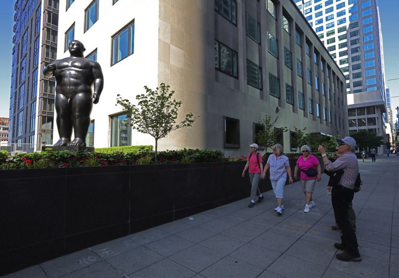 """Seattle developer Martin Selig recently had one of Fernando Botero's nude sculptures, titled """"Adam,"""" installed in downtown Seattle — and it's attracting attention. (Steve Ringman/The Seattle Times)"""
