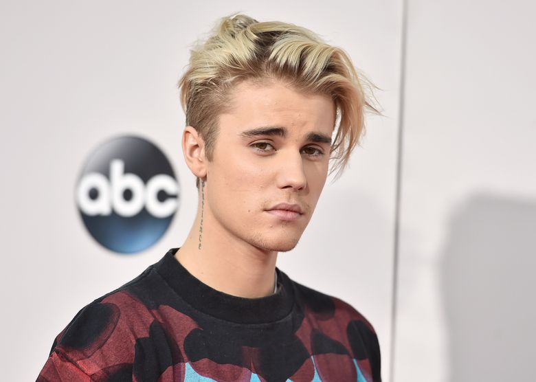 """FILE – In this Sunday, Nov. 22, 2015 file photo, Justin Bieber arrives at the American Music Awards at the Microsoft Theater in Los Angeles. A singer songwriter has sued Bieber and Skrillex for copyright infringement over their multi-platinum song, """"Sorry."""" Casey Dienel, who performs under the name White Hinterland, filed suit against the two performers as well as their publishing companies, Universal Music and co-writers in federal court in Nashville, Tennessee, on Wednesday, May 25, 2016, which claims that """"Sorry"""" uses a vocal riff from her song """"Ring the Bell."""" (Photo by Jordan Strauss/Invision/AP, File)"""