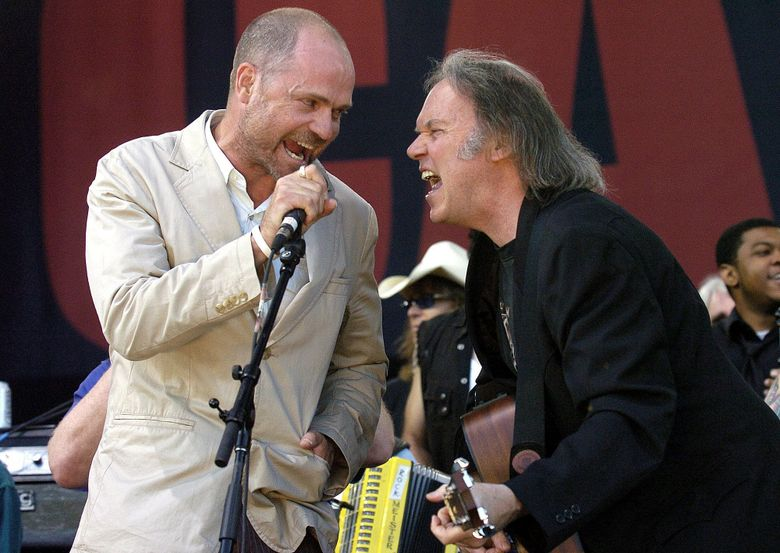 FILE – In this July 2, 2005, file photo, Gord Downie of The Tragically Hip (left) and Neil Young perform during the finale of the Canadian Live 8 concert in Barrie, Ont. The Tragically Hip announced Tuesday, May 24, 2016, that Downie has been diagnosed with terminal brain cancer. (Aaron Harris/The Canadian Press via AP, File)