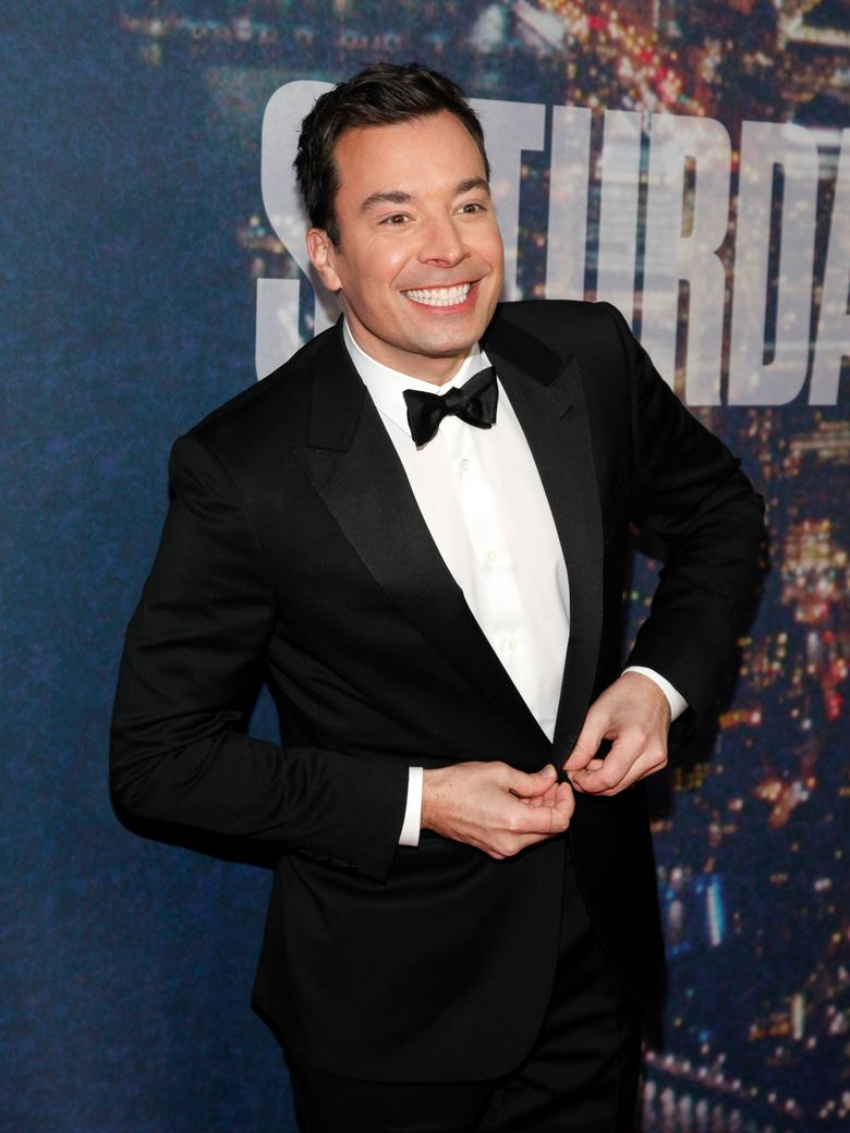 """FILE – In this Feb. 15, 2015 file photo, Jimmy Fallon attends the SNL 40th Anniversary Special in New York. Fallon donned a period costume Monday, May 16, 2016, for a """"Hamilton"""" takeoff at NBC's annual presentation of next season's schedule. The """"Tonight"""" show host walked down the aisle at Radio City Music Hall for a comic spoof on the business of television. (Photo by Andy Kropa/Invision/AP, File)"""