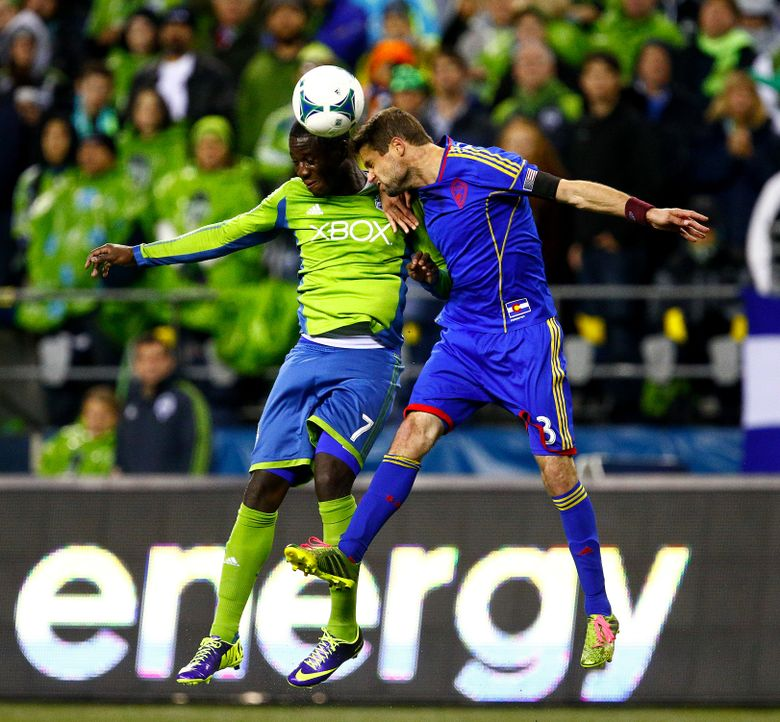 SoundersFC player Eddie Johnson, left, fights for the ball against Drew Moor in the second half in an MLS playoff match at CenturyLink Field on Wednesday, October 30, 2013, in Seattle, Wash.  (John Lok/The Seattle Times)