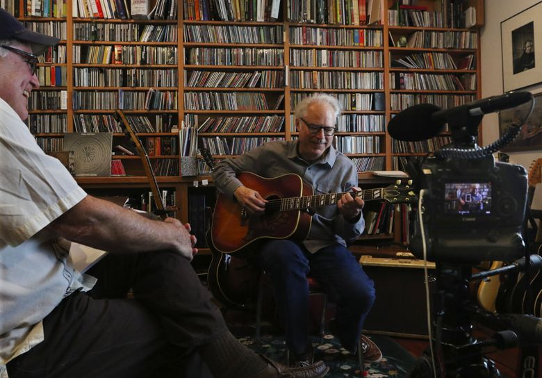 Virtuoso guitarist Bill Frisell plays acoustic versions of Woody Guthrie songs as he and Seattle Times music critic Paul de Barros talk about the legendary singer-songwriter's work.  (Alan Berner/The Seattle Times)