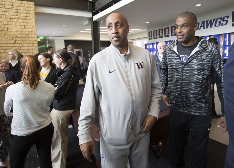 UW mn's basketball coach Lorenzo Romar, center, was present as UW President Ana Mari Cauce, introduces Jennifer Cohen as the new athletic director at the University of Washington. (Mike Siegel/The Seattle Times)