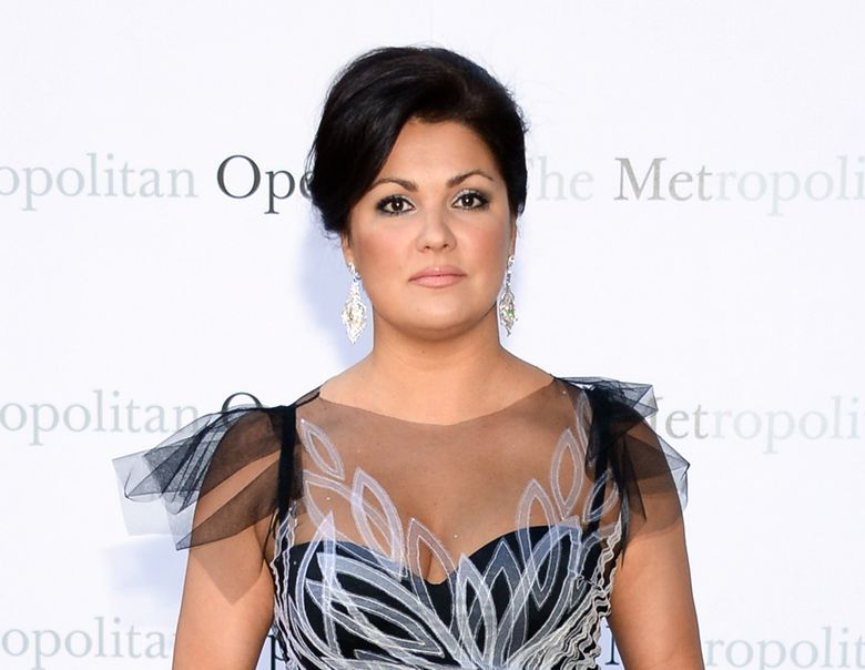 """FILE – In this Sept. 22, 2014 file photo, soprano Anna Netrebko attends the Metropolitan Opera 2014-15 season opening production of Mozart's """"Marriage of Figaro"""" at Lincoln Center in New York. New York's Metropolitan Opera said Tuesday, May 3, 2016, it will replace Netrebko with Sonya Yoncheva in Bellini's """"Norma"""" opening Sept. 12.   (Photo by Evan Agostini/Invision/AP, File)"""