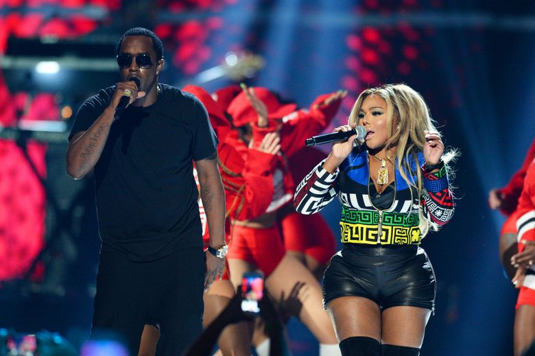 FILE – In this Sept. 19, 2015, file photo, Puff Daddy, left, performs with Lil Kim at the 2015 iHeartRadio Music Festival in Las Vegas. Puff Daddy is reuniting with Lil Kim, Mase, Faith Evans and more for a Bad Boy Records reunion tour kicking off Aug. 25, 2016, in Columbus, Ohio. (Photo by Al Powers/Powers Imagery/Invision/AP, File)