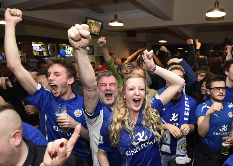 Leicester City supporters celebrate at Market Tavern after the English Premier League soccer match between Chelsea and Tottenham Hotspur, in Leicester, Britain, 02 May 2016. Leicester was crowned English Premier League champions for the first time in the club's history, clinching the title after a tie between Chelsea and Tottenham.  EPA/FACUNDO ARRIZABALAGA
