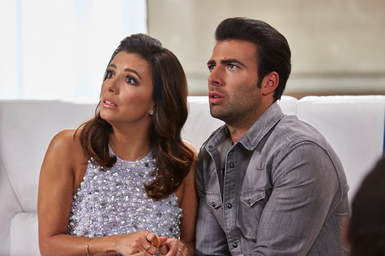 """This image released by NBC shows Eva Longoria as Ana Sofia Calderon, left, and Jencarlos Canela as Xavier Castillo in a scene from the NBC comedy series, """"Telenovela."""" NBC canceled the comedy spoof of the Spanish-language soap operas, Friday, May 13, 2016, after only a few months on the air. (Ben Cohen/NBC via AP)"""