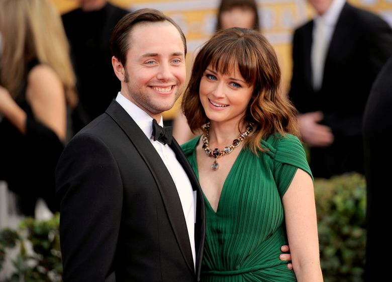 FILE – In this Jan. 27, 2013, file photo, actors Vincent Kartheiser, left, and Alexis Bledel pose at the 19th Annual Screen Actors Guild Awards at the Shrine Auditorium in Los Angeles. Representatives for both actors confirmed on May 19, 2016, that the couple welcomed a baby boy in the fall of 2015. (Photo by Chris Pizzello/Invision/AP, File)