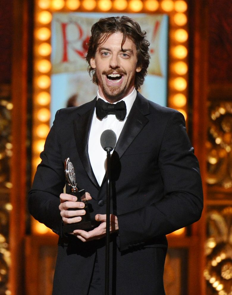 """FILE – In this June 7, 2015 file photo, Christian Borle accepts the award for best performance by an actor in a featured role in a musical for """"Something Rotten!"""" at the 69th annual Tony Awards in New York. Borle will star as Willy Wonka in the musical """"Charlie and the Chocolate Factory"""" when it comes to Broadway. It will start performances in March 2017 at the Lunt-Fontanne Theatre. (Photo by Charles Sykes/Invision/AP, File)"""
