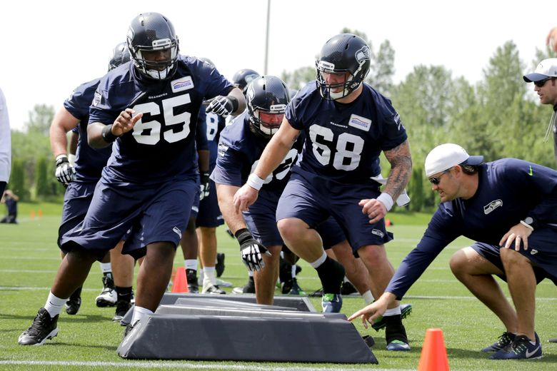 Seattle Seahawks offensive linemen Patrick Lewis (65) and Justin Britt (68) participate in organized team activities on Wednesday. (Johnny Andrews / The Seattle Times)