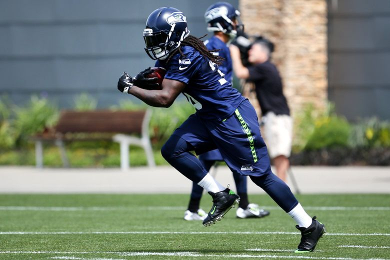Seattle Seahawks running back Alex Collins participates in organized team activities on Wednesday. (Johnny Andrews / The Seattle Times)