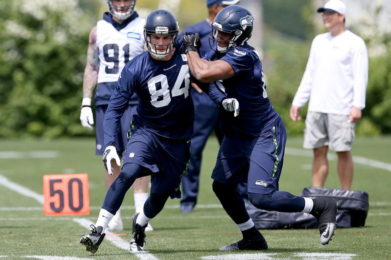 Seattle Seahawks tight end Cooper Helfet (left) competes against tight end Brandon Williams (right) during organized team activities on Wednesday. (Johnny Andrews / The Seattle Times)