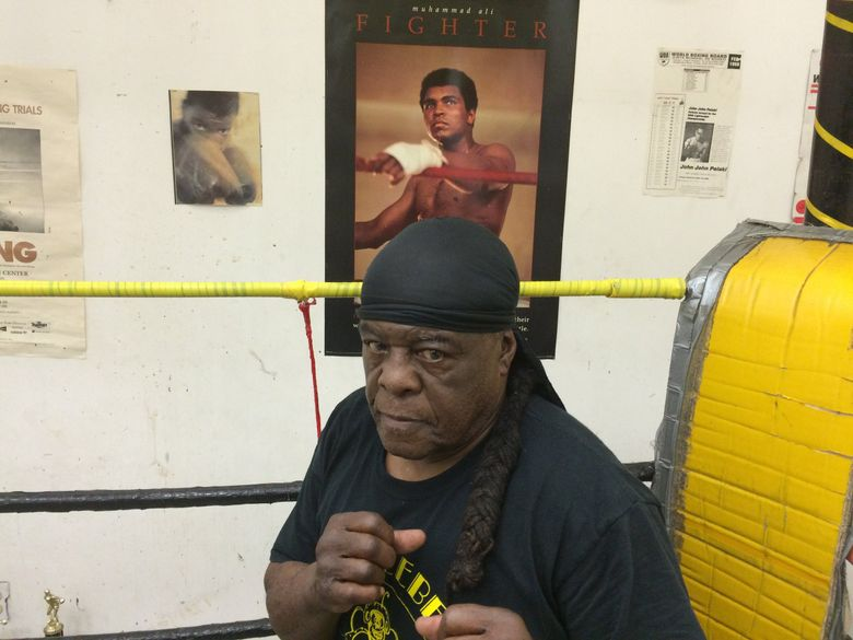 Willie Briscoray, a world-ranked featherweight contender in the 1960s,  talks about Muhammad Ali at the legendary Bumblebee Boxing Club in Seattle. (Erik Lacitis / The Seattle Times)
