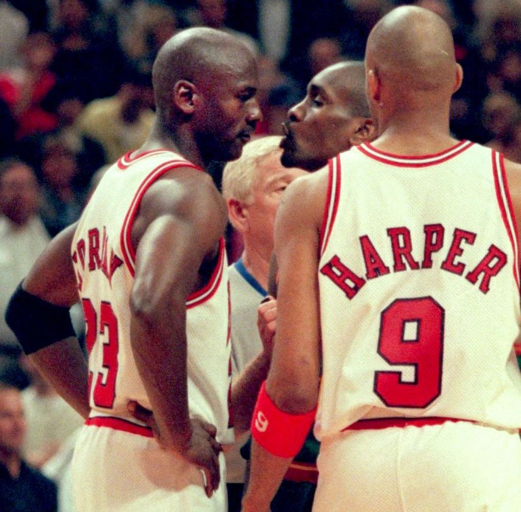 Sonics guard Gary Payton and Bulls guard Michael Jordan exchange words during Game 2 of the 1996 NBA Finals in Chicago. (Rod Mar/The Seattle Times)