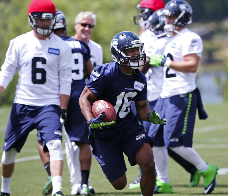 Wide receiver Tyler Lockett (16) participates in a drill during the Seahawks mini-camp, Wednesday, June 15, 2016, at VMAC in Renton. (Ken Lambert / The Seattle Times)