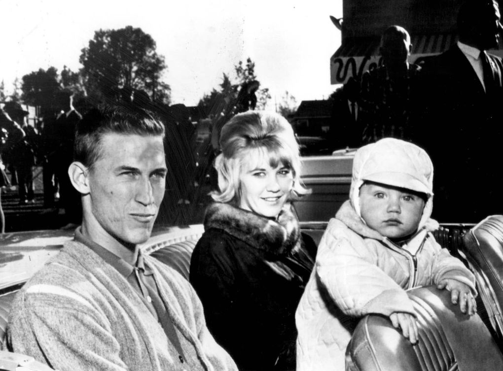 Ten-month-old Mel Stottlemyre Jr. stares at the camera while father Mel. Sr. and mother Jean wait for a parade to start in their hometown of Mabton, Wash., in 1964. (Seattle Times archive)