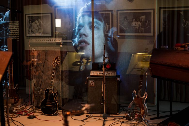 FILE – In this April 4, 2016, file photo, an image of Mick Jagger forms the backdrop of a recreated music studio as part of Exhibitionism, the interactive multimedia exhibition of the Rolling Stones' career so far, at the Saatchi gallery in Kings Road, London. The Rolling Stones are bringing their exhibition of more than 500 recording and artifacts from the band's archive to New York City in November 2016. (Photo by Joel Ryan/Invision/AP, File)