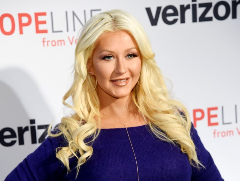 """FILE – In this Nov. 12, 2015 file photo, Christina Aguilera poses at an event supporting HopeLine From Verizon, a new campaign supporting domestic violence prevention and awareness in West Hollywood, Calif. Aguilera has released a new song, """"Change,"""" following the mass shooting at an Orlando nightclub. The singer posted a lyric video of the song and a statement on her website on Thursday, June 16, 2016. (Photo by Chris Pizzello/Invision/AP, File)"""