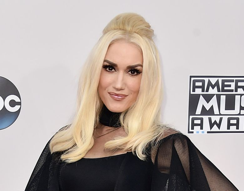 """FILE – In this Nov. 22, 2015 file photo, Gwen Stefani arrives at the American Music Awards in Los Angeles. Stefani says she and her fellow coaches on """"The Voice"""" are shocked and horrified by the death of season six contestant Christina Grimmie. """" Grimmie, a 22-year-old singer and YouTube star, was killed Friday, June 10, 2016, as she signed autographs after a show in Orlando.  (Photo by Jordan Strauss/Invision/AP, File)"""