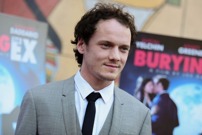 """FILE – In this June 11, 2015, file photo, Anton Yelchin arrives at a special screening of """"Burying the Ex"""" held at Grauman's Egyptian Theatre in Los Angeles. Yelchin, a charismatic and rising actor best known for playing Chekov in the new """"Star Trek"""" films, has died at the age of 27. He was killed in a fatal traffic collision early Sunday morning, June 19, 2016, his publicist confirmed. (Photo by Richard Shotwell/Invision/AP, File)"""
