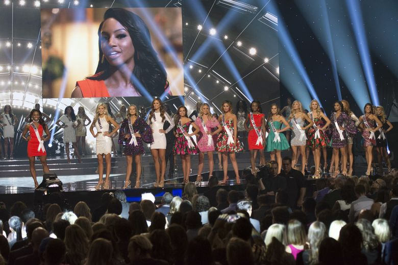 The top 15 contestants stand on stage during the 2016 Miss USA pageant in Las Vegas, Sunday, June 5, 2016. (Jason Ogulnik/Las Vegas Review-Journal via AP) LOCAL TELEVISION OUT; LOCAL INTERNET OUT; LAS VEGAS SUN OUT