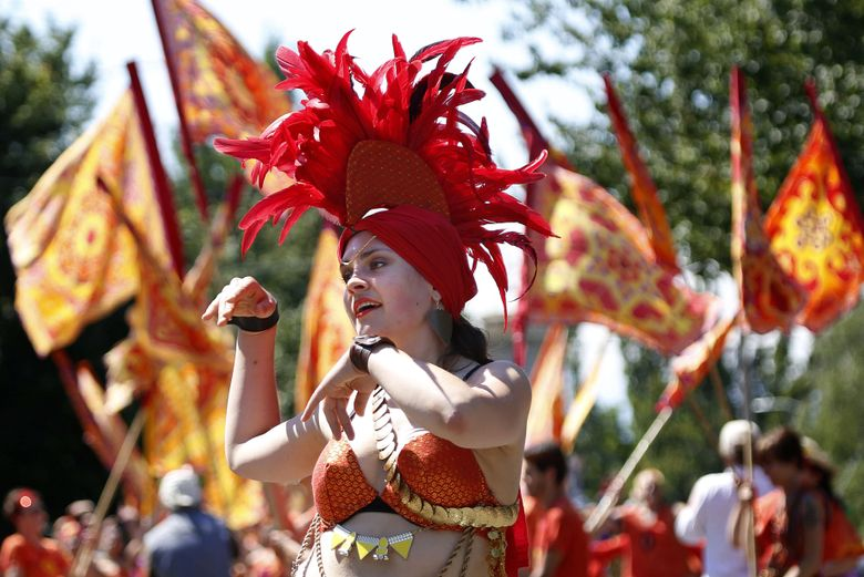 Julia Eckels, one of the five Fantasias in the float Gira Sol, dances down North 36th Street during the 2015 Fremont Solstice Parade. This year's parade is Saturday, June 18. (Sy Bean / The Seattle Times)
