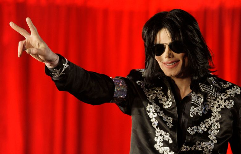 """FILE – In this March 5, 2009 file photo, US singer Michael Jackson speaks at a press conference at the London O2 Arena. Filmmaker J.J. Abrams is adapting a new book , """"Before You Judge Me: The Triumph and Tragedy of Michael Jackson's Last Days,"""" for TV with its co-author, TV and radio host Tavis Smiley. Written by Smiley and David Ritz, it's described as a novelistic take on the pop star's final months. (AP Photo/Joel Ryan, File)"""