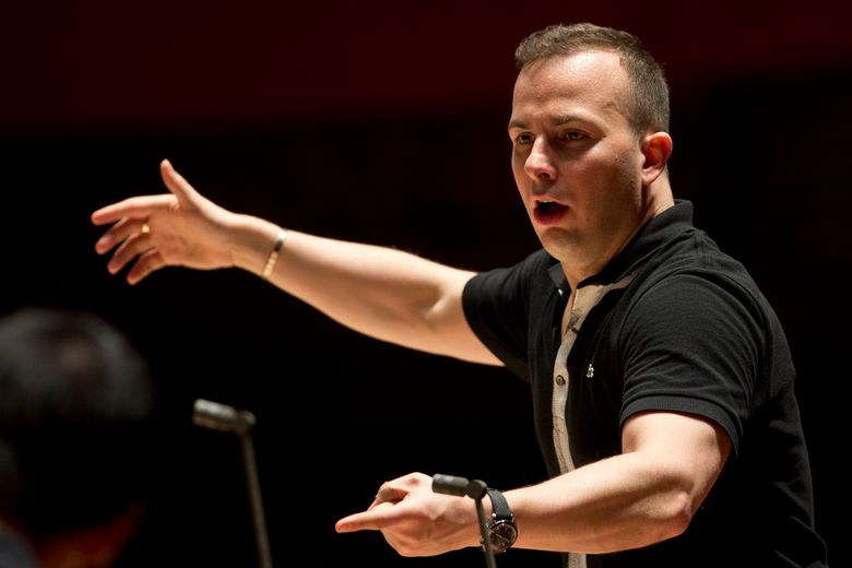 FILE – In this  Oct. 17, 2012, file photo, the Philadelphia Orchestra rehearses with its new music director and conductor Yannick Nezet-Seguin at the Kimmel Center, in Philadelphia. Nezet-Seguin will succeed James Levine as music director of the Metropolitan Opera but will not take over until the 2020-21 season. (AP Photo/Matt Rourke, File)