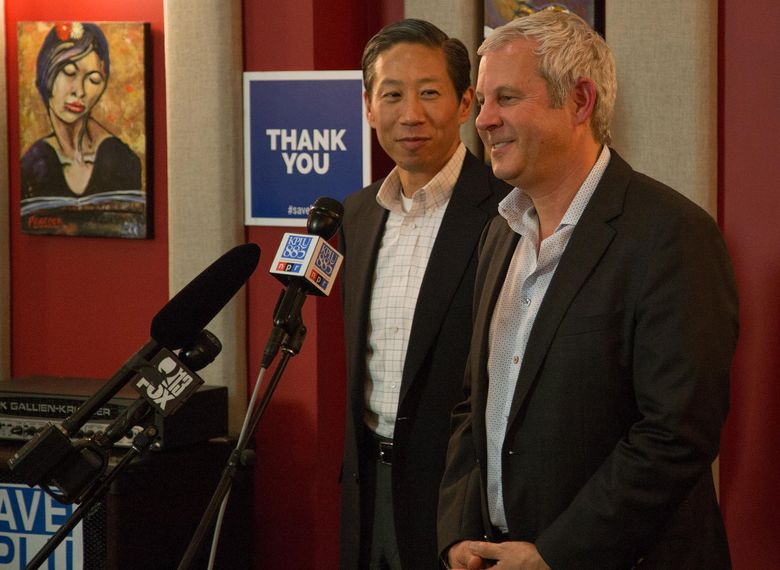 KPLU general manager Joey Cohn, right, and Stephen Tan chairman of Friends of 88.5 FM address media and supporters on May 26, after announcing that the Save KPLU campaign had hit its fundraising goal.  (Justin Steyer/KPLU)