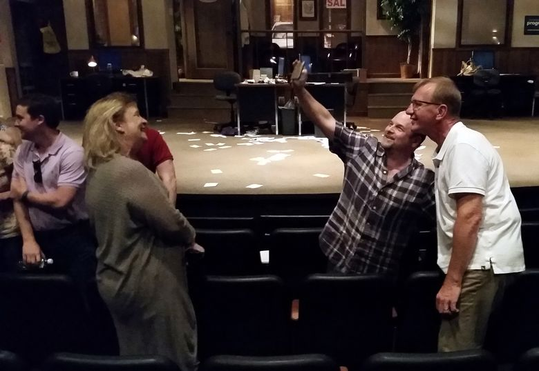 """As Stacy Sells, second from left, looks on, entertainer Jason Alexander, second from right, takes a selfie with Tim Gauger after a preview show of """"Windfall"""" at the Arkansas Repertory Theatre on Sunday, June 5, 2016, in Little Rock, Arkansas. Alexander directed the two-act play, which explores how people might react if they feel a co-worker is cheating them out of lottery jackpot money. The play premiered in Little Rock June 10, 2016. (AP Photo/Kelly Kissel)"""