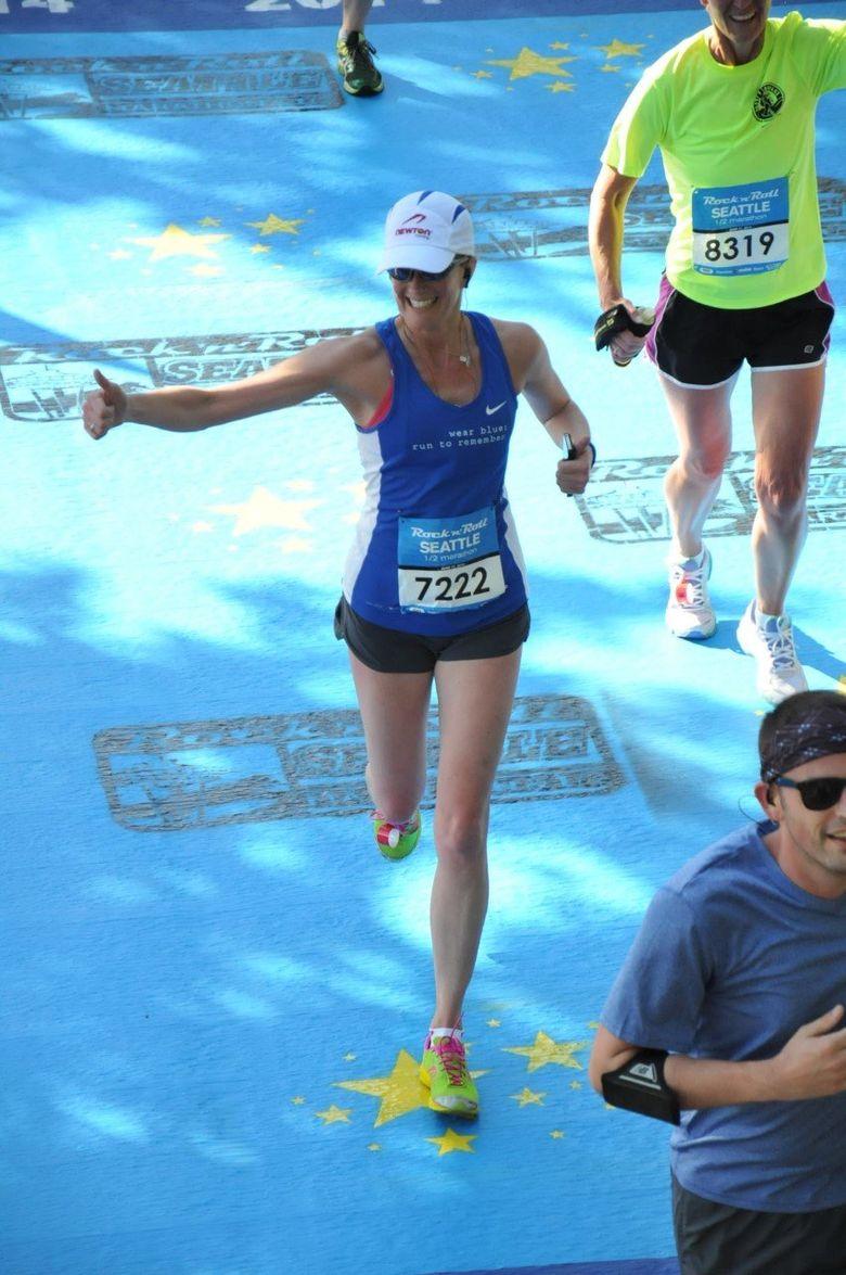 Former Seattle resident Gretchen Schoenstein, shown in the Seattle Rock 'n' Roll Half-Marathon in 2014, returns home to run in the same race Saturday despite a debilitating auto-immune disorder (MarathonFoto).
