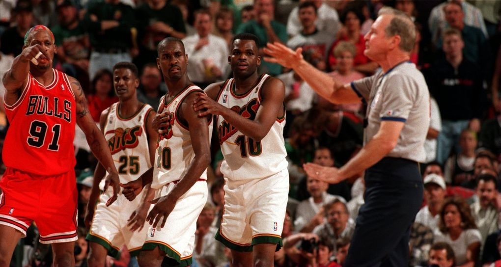 Chicago forward Dennis Rodman, left, is called for a technical foul during Game 4 of the 1996 NBA Finals in front of Sonics players (from left) David Wingate, Gary Payton and Nate McMillan. (Seattle Times file)