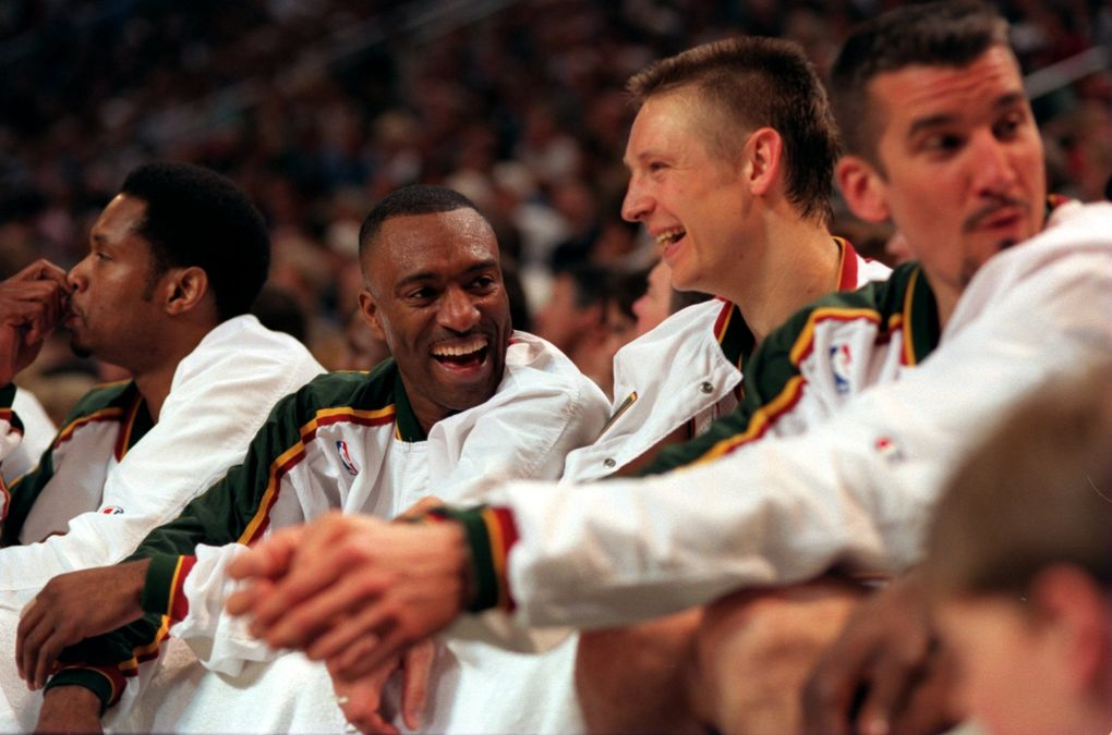 From left, Sam Perkins, Hersey Hawkins, Detlef Schrempf and Frank Brickowski sit on the bench during a 1996 postseason game. (Dean Rutz / The Seattle Times)